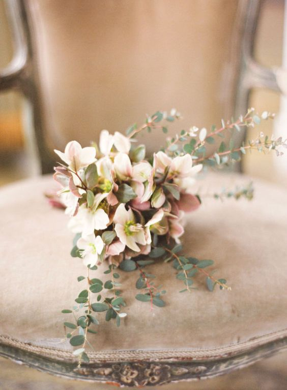 romantic blush bouquet on vintage chair