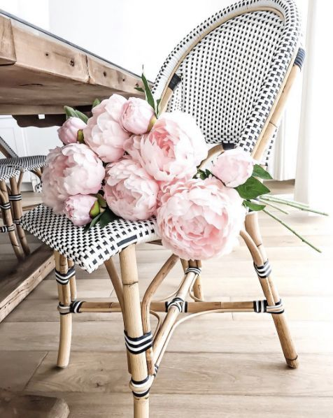 peonies on rattan chair