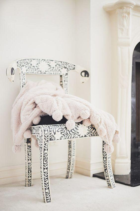 blush throw blanket on chair