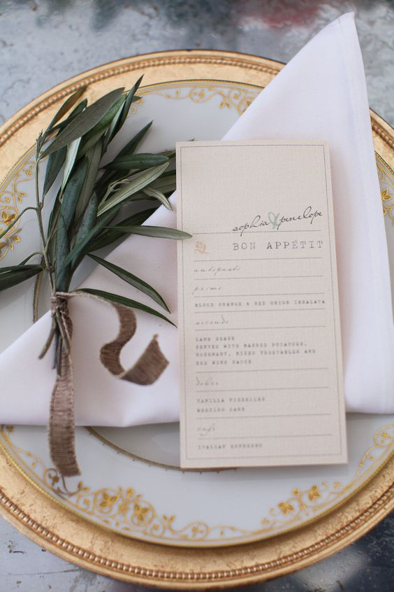 golden plates with menu and olive branch