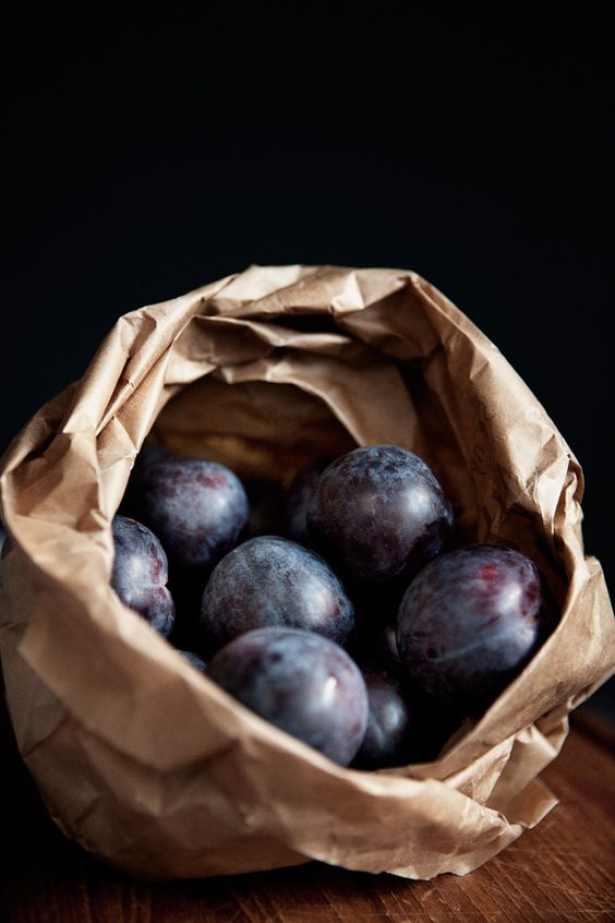 plums in paper bag